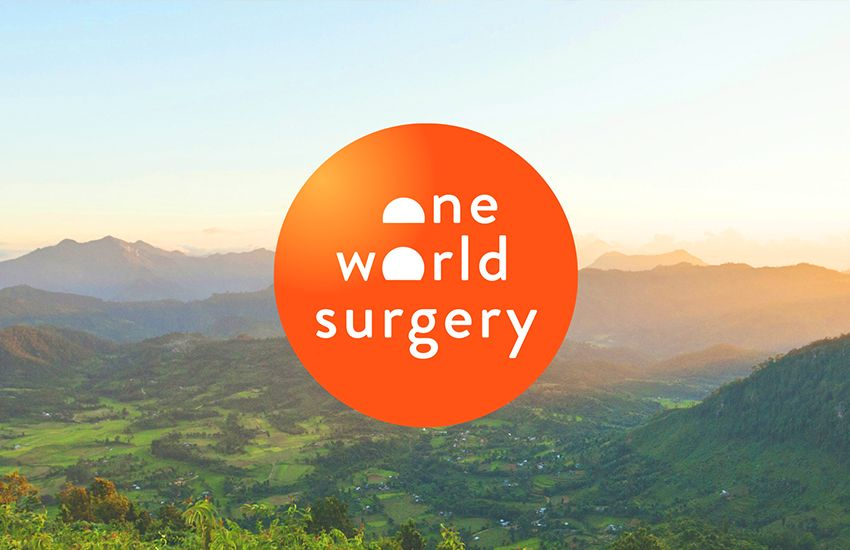 One World Surgery sunrise over trees and mountains behind logo